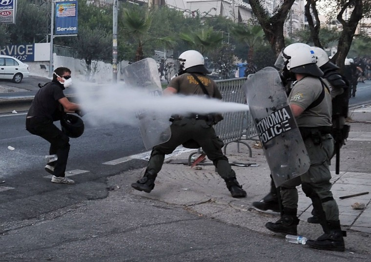 Police spray a protester with tear gas during clashes with anti-fascist demonstrators in the western Athens working-class suburb of Keratsini. (LOUISA GOULIAMAKI / AFP/Getty Images)