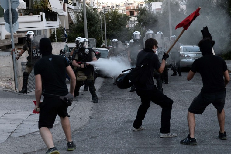 Greek demonstrators clash with riot police in Athens. (ARIS MESSINIS / AFP/Getty Images)