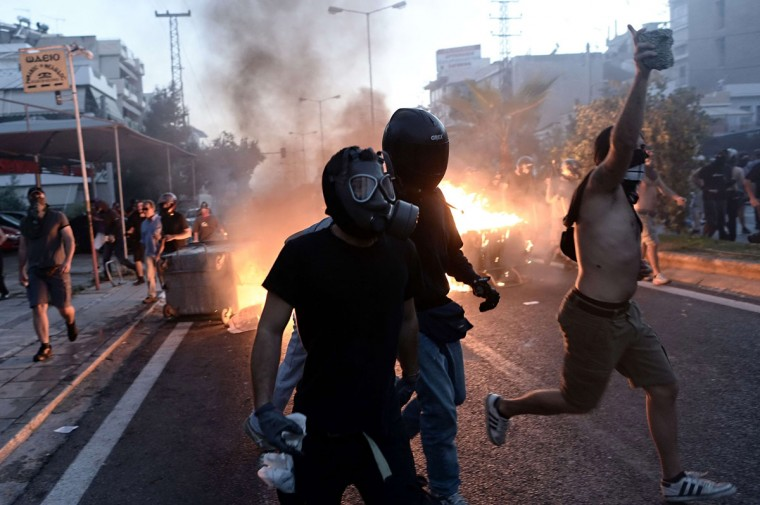 Anti-fascist demonstrators clash with riot police in Athens after a leftist musician was murdered by a suspected neo-Nazi. (ARIS MESSINIS / AFP/Getty Images)