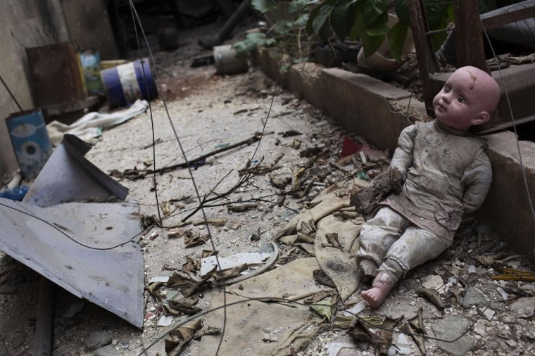 "A doll lies amid debris on the front line in the Saif al-Dawla district of the northern Syrian city of Aleppo on September 19, 2013. US Secretary of State John Kerry urged China to play a ""positive, constructive"" role at the United Nations on a resolution to rein in Syria's chemical weapons. (JM Lopez/AFP/Getty Images)"