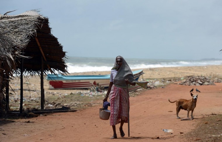 In this photograph taken on August 23, 2013, a Tamil woman walks in the north western village of Udappuwa, from which many people have travelled illegally to Australia, making Udappuwa one of the hot spots for illegal migration. As Australia's new government launches tough measures to halt asylum seekers arriving on boats, some dirt-poor fishermen and their families half a world away in Sri Lanka seem undeterred. (Lakruan Wanniarchchi/AFP/Getty Images)