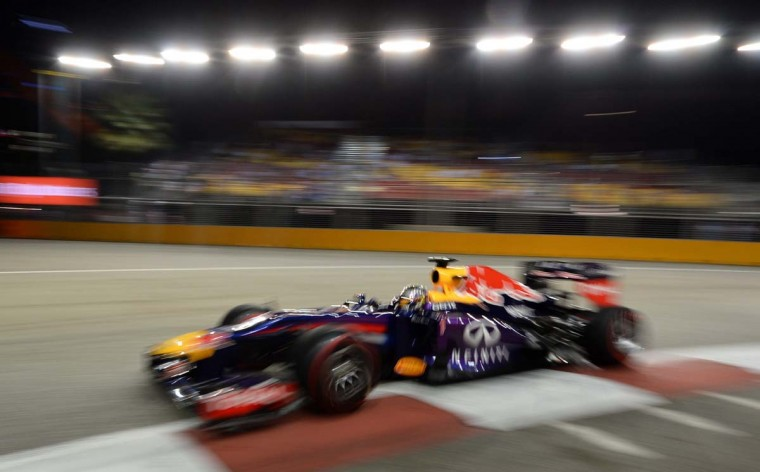 Red Bull driver Sebastian Vettel of Germany speeds up around a corner during his second practice session of the Formula One Singapore Grand Prix on September 20, 2013. (Roslan Rahman/AFP)