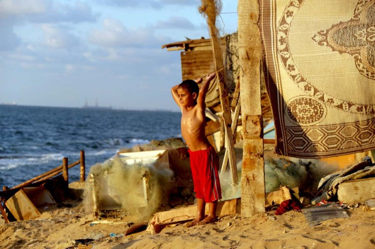 A Palestinian child rest after a swim on the beach near the Shati refugee camp in Gaza City on September 20, 2013. (Mohammed Abed/AFP)