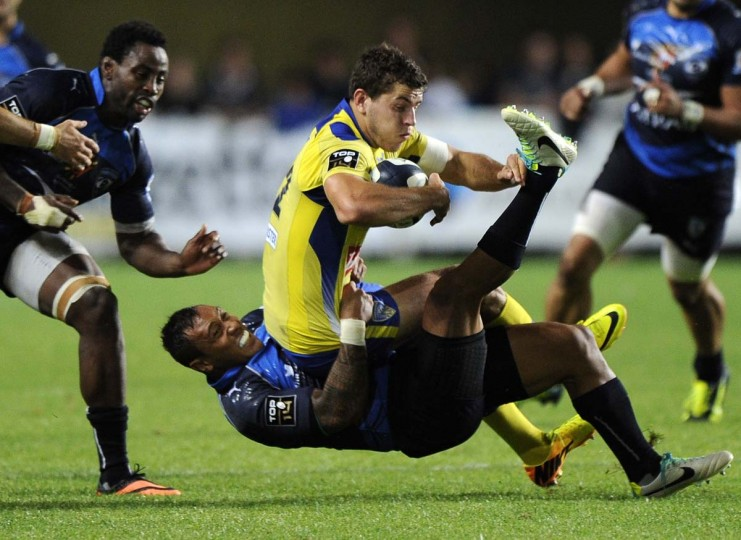 Clermont's Benjamin Kayser is tackled by Montpellier's Anthony Tuitavake during the top 14 rugby union match Montpellier vs Clermont at the Yves du Manoir stadium in Montpellier, on September 20, 2013. (Pascasl Guyot/AFP)