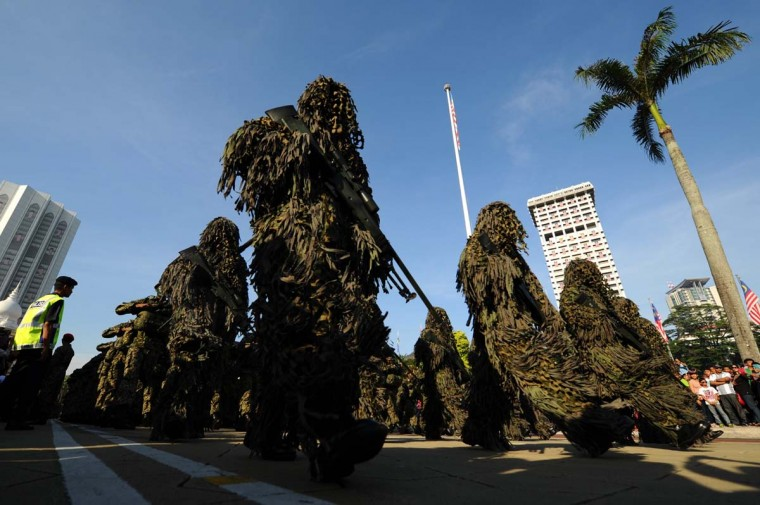 Malaysia's sniper soldier march past during the 80th Army Day parade in Kuala Lumpur on September 21, 2013. The Malaysian army celebrated its 80th anniversary with a grand military parade and a display of military gear at the historical Independence Square. (Mohd Rasfan/AFP)