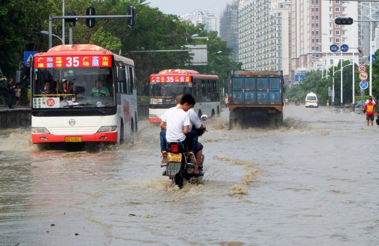 Vehicles run in flooded water in Shantou, south China's Guangdong province. (AFP/Getty Images)