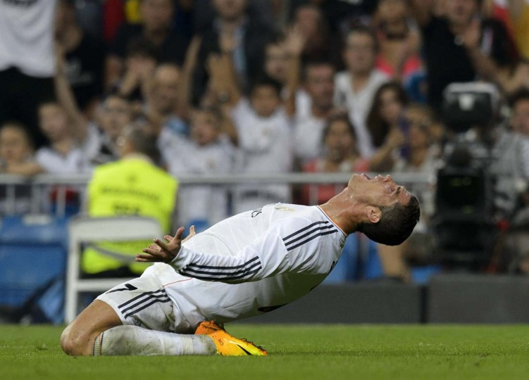 Real Madrid's Portuguese forward Cristiano Ronaldo reacts during the Spanish league football match Real Madrid CF vs Getafe CF at the Santiago Bernabeu stadium in Madrid on September 22, 2013. (Dani Pozo/AFP)