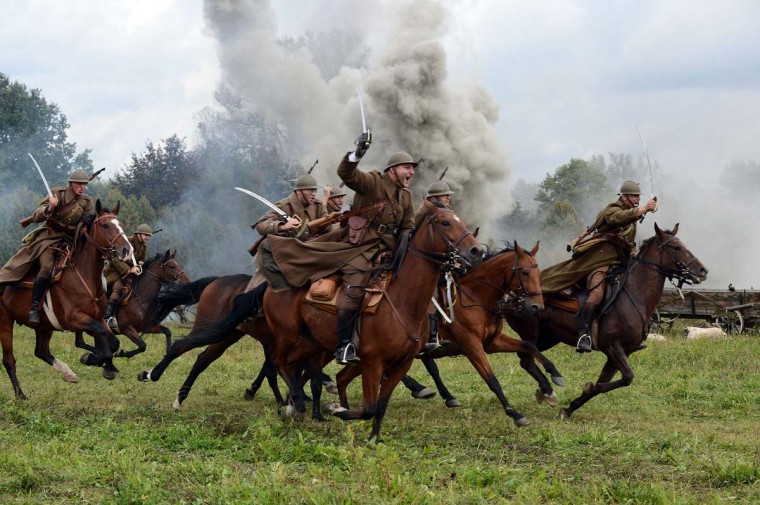 Reconstruction of the battle at the begining of WWII on September 19,1939 in the outskirts of Warsaw between Polish and German armies with last cavalry charge on September 22, 2013 in Lomianki. (Janek Skarzyski/AFP)