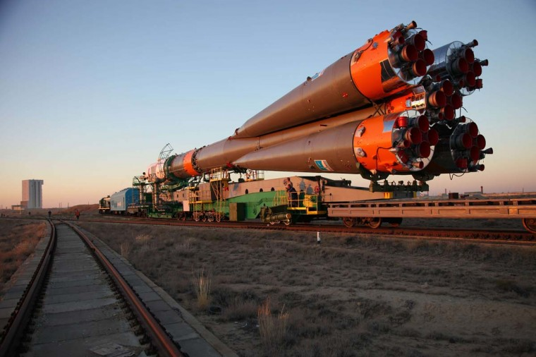 Russian Soyuz-FG rocket with Soyuz TMA-10M spacecraft aboard is transported to a launch pad at the Russian-leased Baikonur cosmodrome in Kazakhstan, on September 23, 2013. Soyuz TMA-10M is a planned transport the Expedition 37 crew, including Michael Hopkins of the US together with Russia's Oleg Kotov and Sergei Ryazansky, to the International Space Station (ISS) on September 26. (AFP)