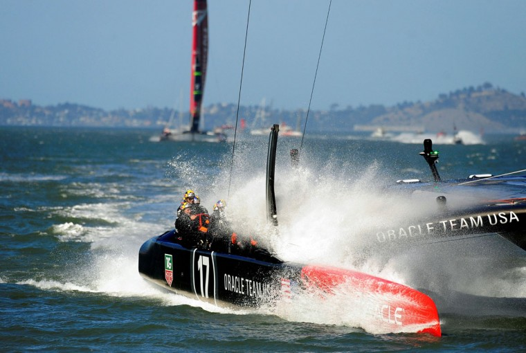 Oracle Team USA splashes down in the water as they pass through the finish line to win race 18 of the 34th America's Cup. (Josh Edelson / AFP/Getty Images)