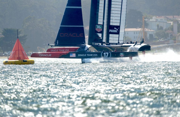 Oracle Team USA passes mark 1 during America's Cup race 17. (Noah Berger / AFP/Getty Images)
