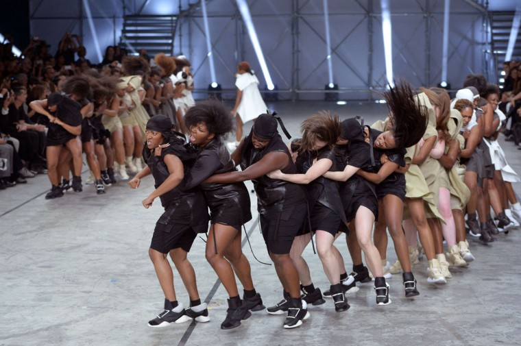 Models dance as they present creations by Rick Owens during the 2014 Spring/Summer ready-to-wear collection fashion show. (MIGUEL MEDINA / AFP/Getty Images)
