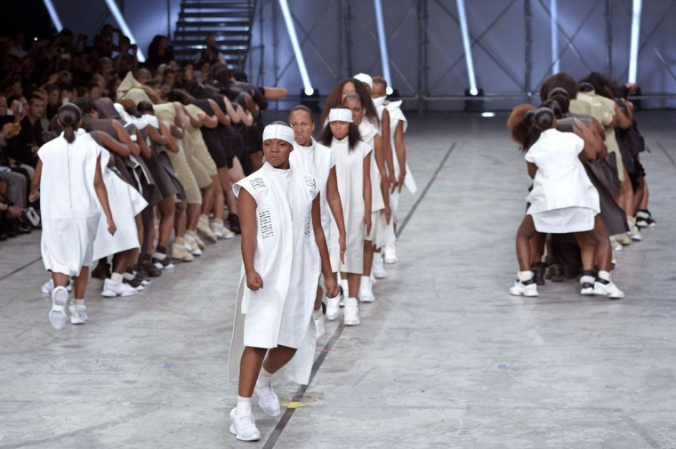 Models perform as they present creations by Rick Owens during the 2014 Spring/Summer ready-to-wear collection fashion show. (MIGUEL MEDINA / AFP/Getty Images)