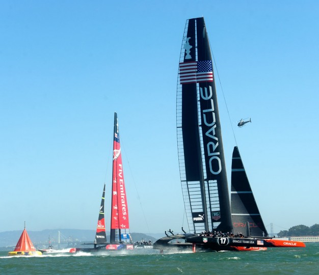 Oracle Team USA sails against Emirates Team New Zealand in America's Cup race 17. (Noah Berger / AFP/Getty Images)