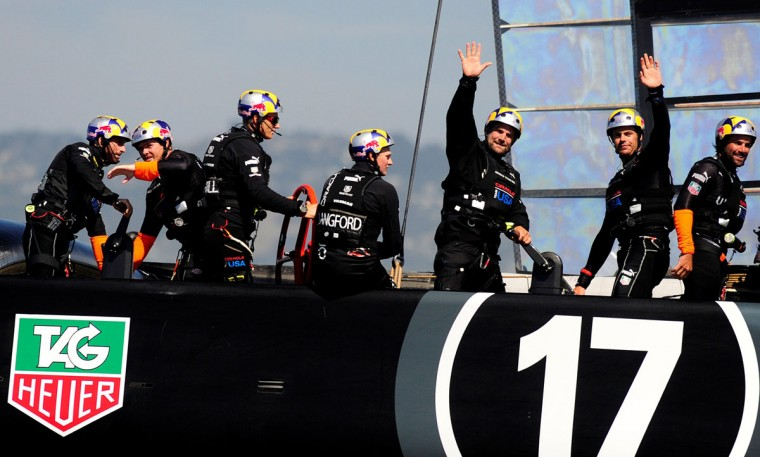 Oracle Team USA waves to spectators after winning race 17 of the 34th America's Cup. (Josh Edelson /AFP/Getty Images)