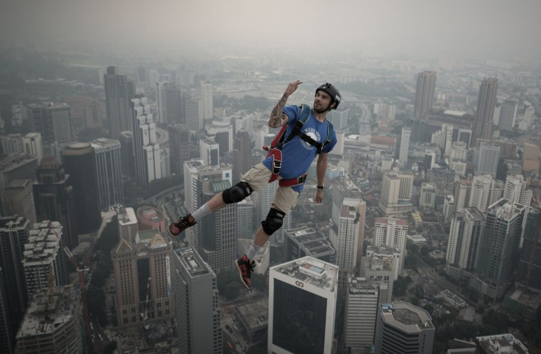 Base jumper Theo Gagliardini leaps from the 300-meter Open Deck of Malaysia's landmark Kuala Lumpur Tower during the International Tower Jump. (MOHD RASFAN / AFP/Getty Images)