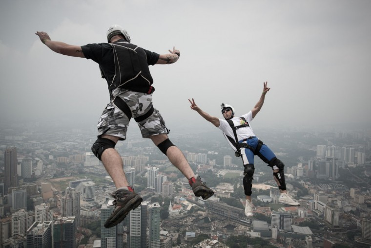 Base jumper Vladimir Spigler, left, and Ivan Colella leap from the 300-meter Open Deck of Malaysia's landmark Kuala Lumpur Tower during the International Tower Jump. (MOHD RASFAN / AFP/Getty Images)