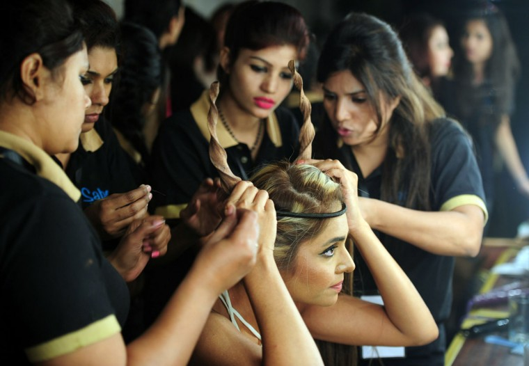 A Pakistani make-up artist prepares a model backstage on the first day of Expo Pakistan 2013 fashion show in Karachi. (ASIF HASSAN / AFP/Getty Images)