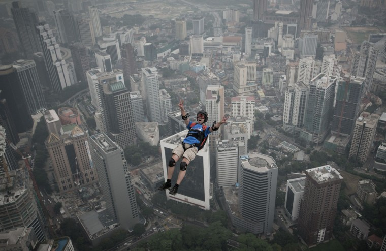 Base jumper Olivier Julien Chacornac leaps from the 300-meter Open Deck of Malaysia's landmark Kuala Lumpur Tower during the International Tower Jump. (MOHD RASFAN / AFP/Getty Images)