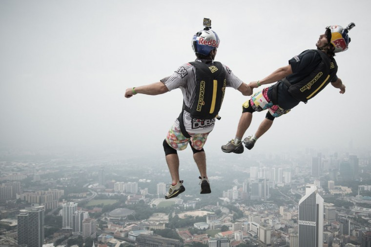 Base jumper Vincent Philippe Benjamin Reffet, right, and Frederic Yves Fugen leap from the 300-meter Open Deck of Malaysia's landmark Kuala Lumpur Tower during the International Tower Jump. (MOHD RASFAN / AFP/Getty Images)