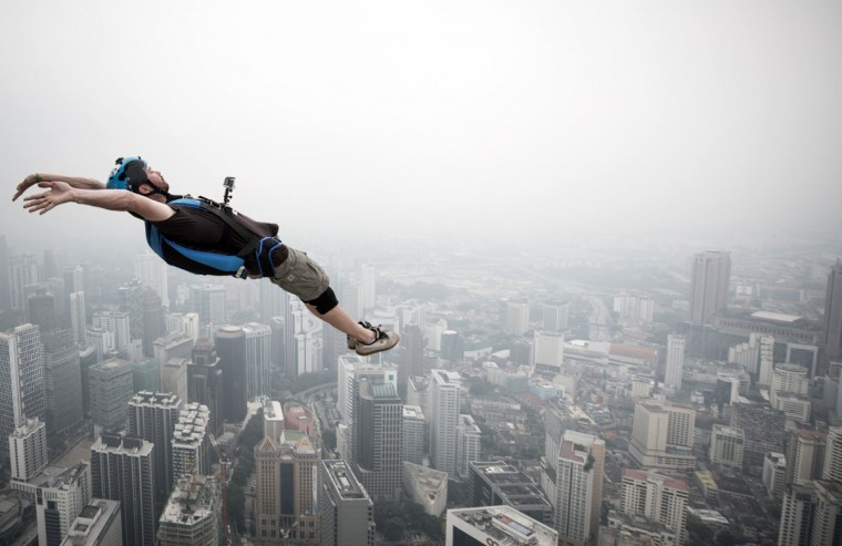 Base jumper Julien Dominique Briquez leaps from the 300-meter Open Deck of Malaysia's landmark Kuala Lumpur Tower during the International Tower Jump. (MOHD RASFAN / AFP/Getty Images)
