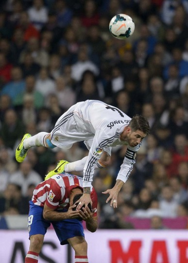 Real Madrid's defender Sergio Ramos vies with Atletico Madrid's Brazilian forward Diego da Silva Costa during the Spanish league football match Real Madrid CF vs Club Atletico de Madrid at the Santiago Bernabeu stadium in Madrid on September 28, 2013. (Dani Pozo/AFP)