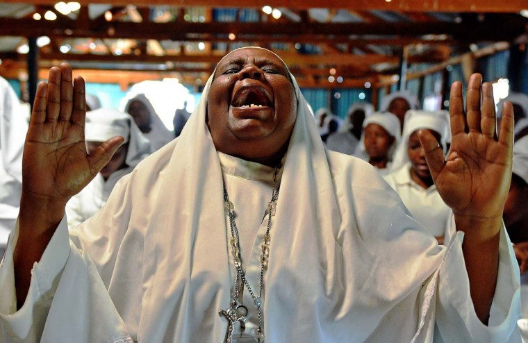A woman screams during a special prayer for the victims of the Westgate mall massacre at the Legio Maria African Mission church on September 29, 2013, in Nairobi. Pressure mounted on the Kenyan authorities a week after the Nairobi mall carnage amid questions over the fate of the missing and accusations on September 28 that top brass failed to heed security warnings. (Carl De Souza/AFP)
