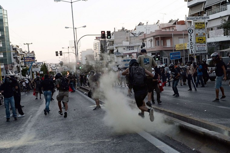 Demonstrators clash with riot police in Athens after a leftist musician was murdered by a suspected neo-Nazi. (ARIS MESSINIS / AFP/Getty Images)