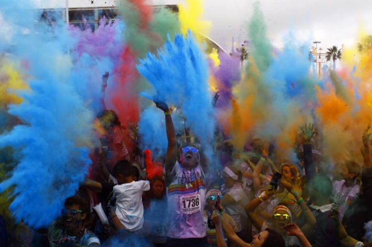 Runners dance and cheer during the festival of color after the Color Run on September 29, 2013 in Guadalajara, Mexico. Considered the world's most joyful 5km race, in which every kilometre a powder of a different dye is thrown in the air at the runners' passage, the event takes place in Mexico for the first time. (Hector Guerrero/AFP)