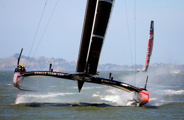 Oracle Team USA comes in to win race 18 of the 34th America's Cup. (Josh Edelson / AFP/Getty Images)