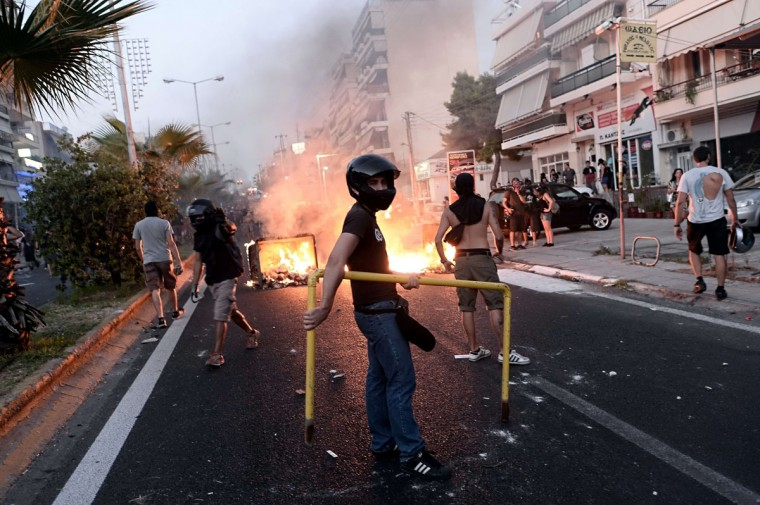 Demonstrators clash with riot police in Athens. (ARIS MESSINIS / AFP/Getty Images)