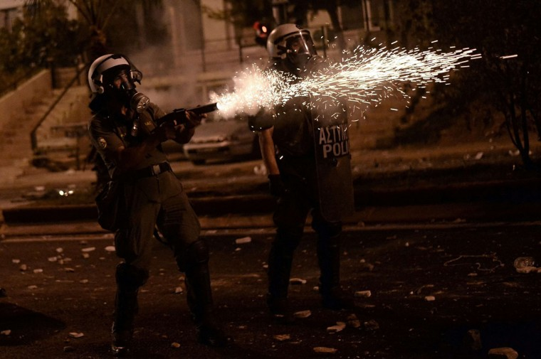 Greek riot police fire tear gas toward protesters during clashes in Athens. (ARIS MESSINIS / AFP/Getty Images)