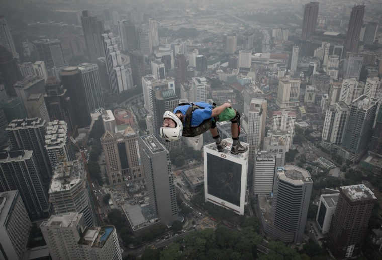 Base jumper Denis Odintsov leaps from the 300-meter Open Deck of Malaysia's landmark Kuala Lumpur Tower during the International Tower Jump. (MOHD RASFAN / AFP/Getty Images)