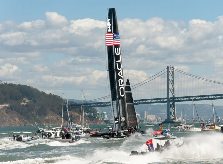 Fleet and spectator boats follow Oracle Team USA as it celebrates its victory over Emirates Team New Zealand in the 34th America's Cup. (Noah Berger / AFP/Getty Images)