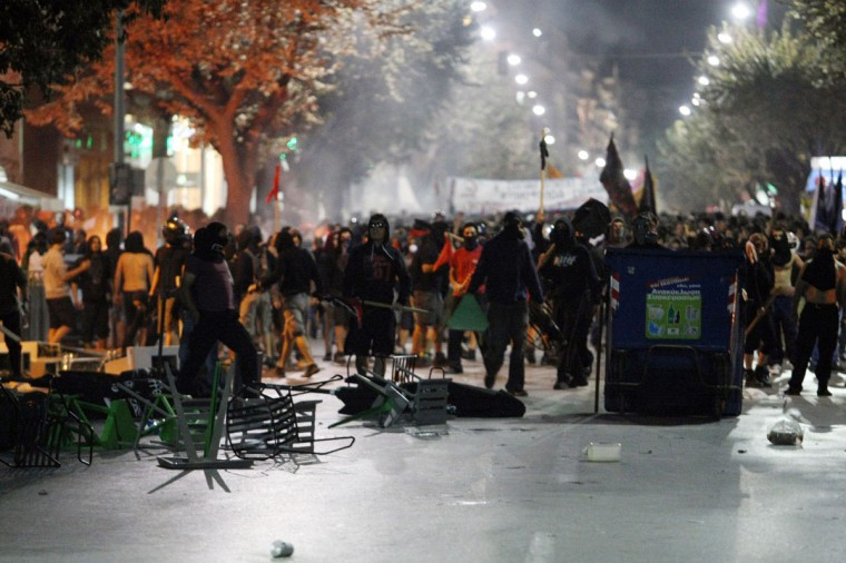 Greek demonstrators clash with riot police in Thessaloniki. (SAKIS MITROLIDIS / AFP/Getty Images)