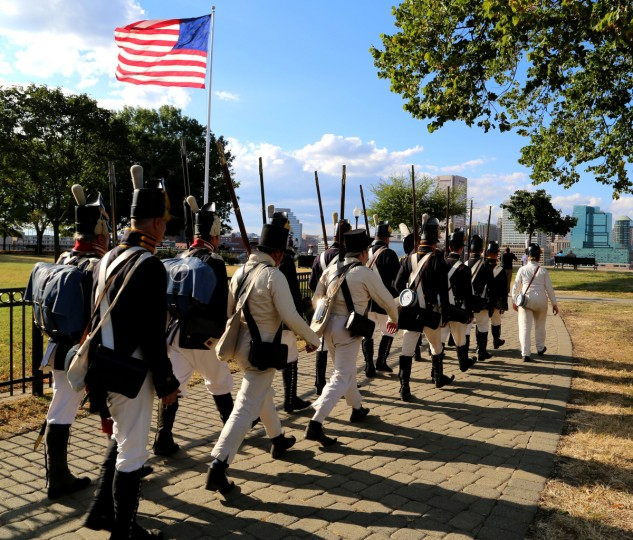 A re-enactment group marches on top of Federal Hill in honor of Defenders' Day. (Kaitlin Newman/Baltimore Sun)