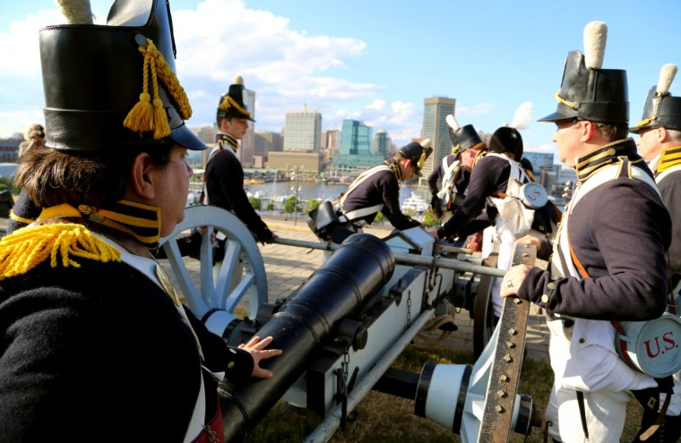 Re-enactors load a cannon on top of Federal Hill in honor of Defenders' Day. (Kaitlin Newman/Baltimore Sun)