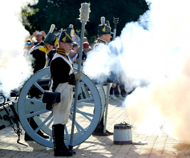 Mark Fadrowski braces himself for the loud noise from the six pound cannon on top of Federal Hill in honor of Defenders' Day.