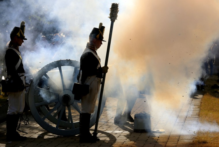 Mark Fadrowski fires the six pound cannon on top of Federal Hill in honor of Defenders' Day.