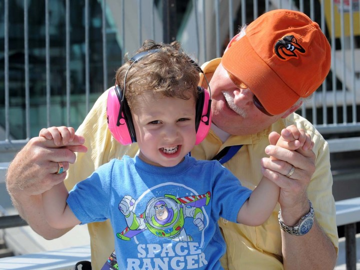 Mason Mayerman, 2, held by his father, Paul Mayerman from Ellicott City, Md., is prepared for the race with pink headphones. (Algerina Perna/Baltimore Sun)