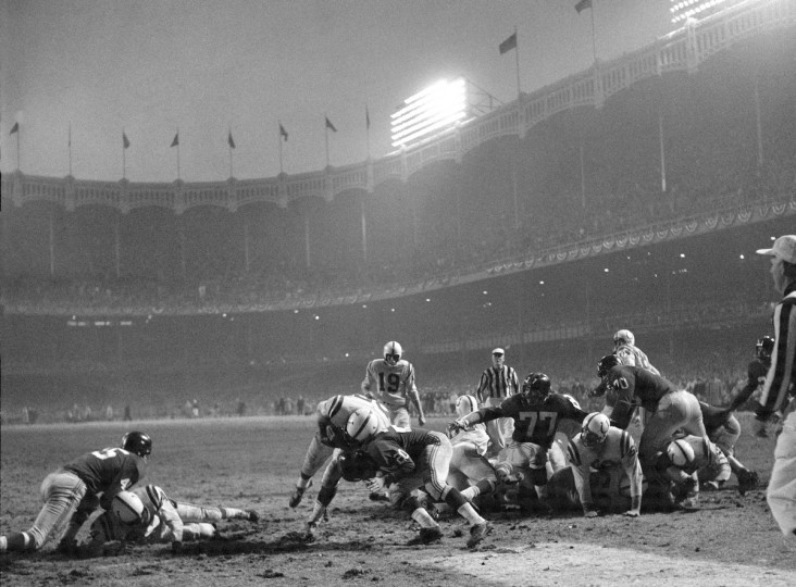 12/28/1958 - Baltimore Colts Alan Ameche (35) in action, scoring the game winning touchdown vs the New York Giants J during sudden death overtime at Yankee Stadium. Bronx, NY. (Neil Liefer/Sports Illustrated)