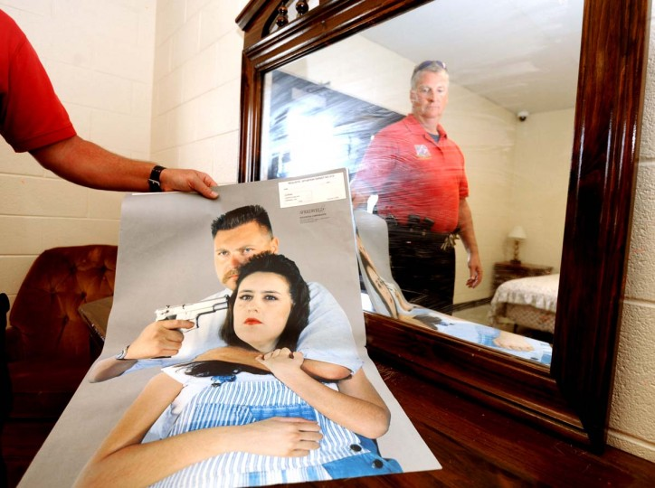 "Lt. Robert Wagner is pictured in the upstairs bedroom of a simulated town home used by police officers in training for simulated domestic calls. The town house and poster showing a man holding a woman at gunpoint is used in the Citizens Police Academy (CPA) program, a free 11-week course. According to the Howard County, MD government website for the Citizens Police Academy, the program gives ""participants an inside look into the department's day-to-day operations, and provides an understanding of what it is really like to be a police officer in Howard County."" Instead of the poster, the officers use other officers to role play to make the training as realistic as possible. Algerina Perna/Baltimore Sun"