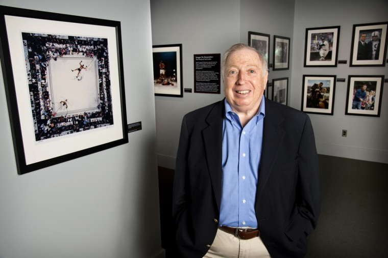 Photographer Neil Leifer stands among some of his photographs that are on display at the Sports Legends Museum. (Christopher T. Assaf/Baltimore Sun)