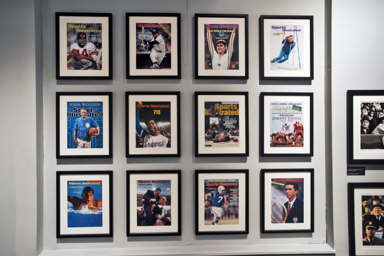 "A collection of Sports Illustrated covers by Neil Leifer on display at the Sports Legends Museum's for their exhibition ""Images We Remember -The World of Neil Leifer."" (Christopher T. Assaf/Baltimore Sun)"