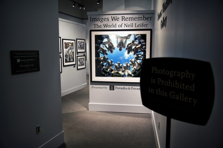 "The entrance to ""Images We Remember -The World of Neil Leifer"" exhibit which will be on display at Sports Legends Museum until October 2014. Included are iconic Leifer photographs such as Alan Ameche's game winning touchdown against the New York Giants in the 1958 NFL championship at Yankee Stadium and heavyweight champion Muhammad Ali standing over Sonny Liston after putting him down for a first-round knock out. (Christopher T. Assaf/Baltimore Sun)"