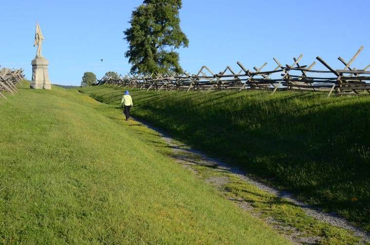 "A view looking at Bloody Lane (also called the Sunken Road) near the observation tower at Antietam National Battlefield. The angle mimics an 1862 stereo (or, 3-D) image called ""Confederate dead in a ditch on the right wing"" - determined to be the first image of Americans lying dead on a battlefield (study and determination by Robert J. Kalasky in book ""Shadows of Antietam""). (Karl Merton Ferron/Baltimore Sun)"