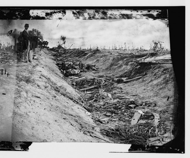 "Determined to be the first photo taken of dead Americans on a battlefield, the right portion of a 3-D photo by Alexander Gardner that he captioned "" Confederate dead in a ditch on the right wing "" following the battle of Antietam. Photos were captured in stereo (or, 3-D) images. (Alexander Gardner/Courtesy Library of Congress)"
