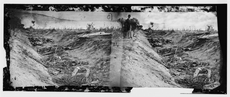 "Determined to be the first photo taken of dead Americans on a battlefield, by Alexander Gardner that he labeled "" Confederate dead in a ditch on the right wing "" following the battle of Antietam. Photos were captured in stereo (or, 3-D) images. (Alexander Gardner/Courtesy Library of Congress)"