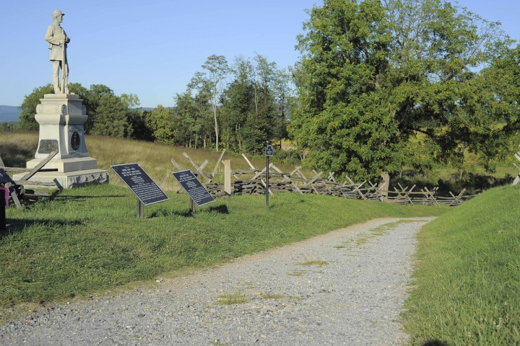 "A view looking into the start of Bloody Lane (also called the Sunken Road) at Antietam National Battlefield. The angle mimics an 1862 stereo (or, 3-D) image called ""Ditch with bodies of soldiers on right wing used as a rifle pit by Confederates. (Karl Merton Ferron/Baltimore Sun)"