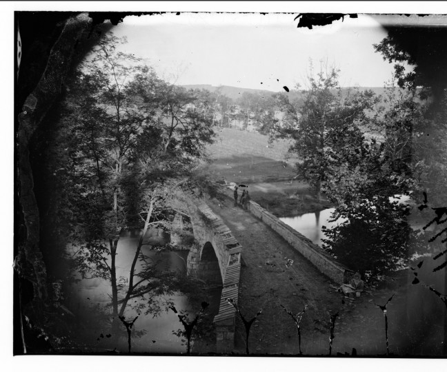 "The left portion of a 3-D photo taken by Alexander Gardner that he labeled ""Antietam Bridge (Burnside Bridge)"", following the battle of Antietam about Sept. 22, 1862. Photos were captured in stereo (or, 3-D) images. (Alexander Gardner/Courtesy Library of Congress)"